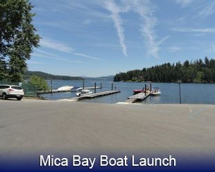 Mica Bay Boat Launch image of parking lot leading to lake